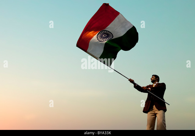 Businessman holding the Indian flag - Stock-Bilder