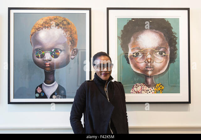 London, UK. 14/10/2015. Artist Ndidi Emefiele from Nigeria poses with her artworks. Press preview of the 1:54 Contemporary - Stock Image