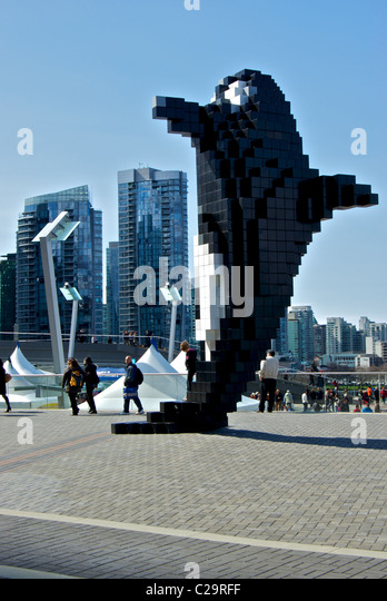 Stylized Doug Coupland Pixel Orca sculpture Jack Poole Plaza with backdrop Vancouver waterfront high rise residential - Stock Image