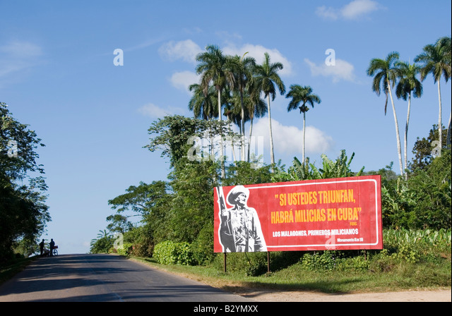 Socialist billboard with political propaganda in the countryside of Viñales Cuba - Stock Image