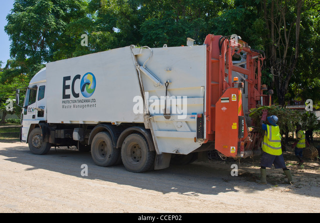 Garbage truck collecting waste in Dar es Salaam Tanzania - Stock Image