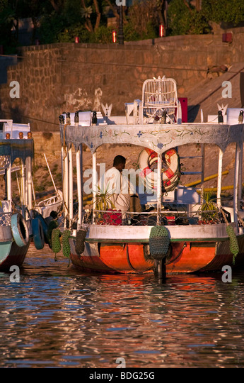 Aswan small colorful passenger ferry boat Nile River Aswan Egypt traditional transport vessel - Stock Image