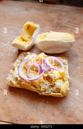 Cows milk soft cheese with Ciabatta bread and onion - Stock Image