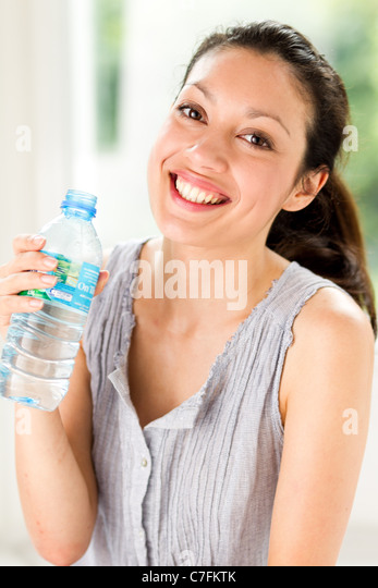 Girl with bottled water - Stock Image