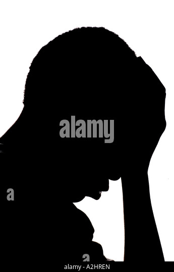 Silhouette of a young African American kid with hand on his head on a white background - Stock Image
