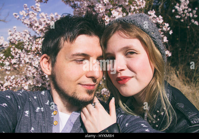 Young happy couple enjoying the spring together - Stock Image