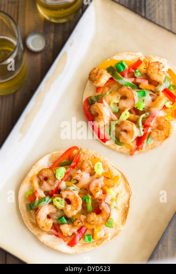 shrimp pizza made of cumin shrimp, red, yellow and orange bell peppers ...