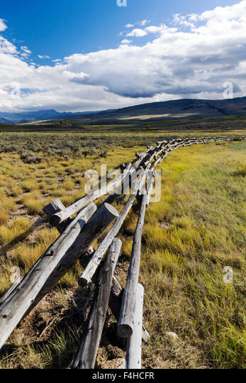 Buck & rail fencing; dirt road off Highway 40 and CR14; North Central Colorado; USA - Stock Image