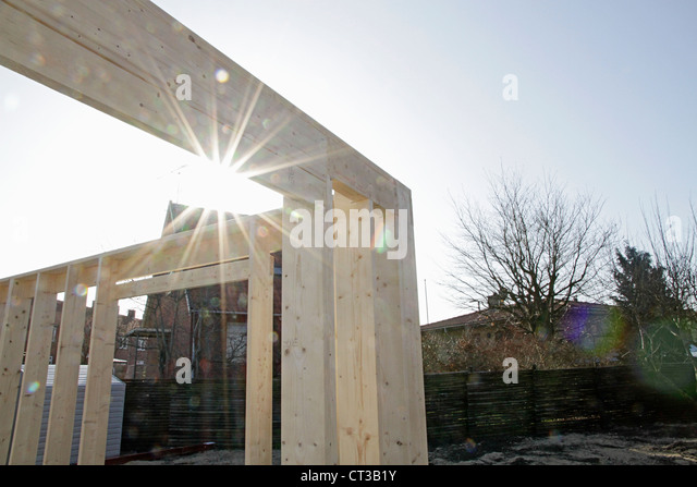Sun shining on new building on site - Stock Image