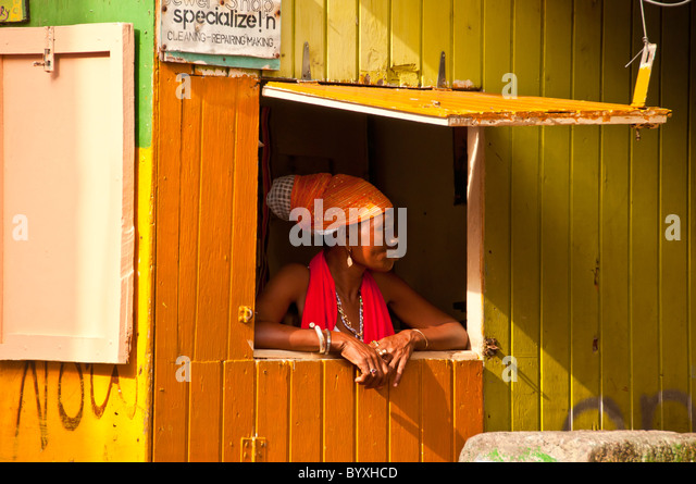 Grenada produce market with woman wearing traditional creole clothing - Stock Image
