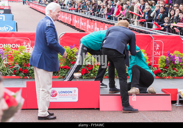 London, UK. 24 April 2016. Prince Harry was the first to help John Disley's widow who stumbled onto the presentation - Stock Image