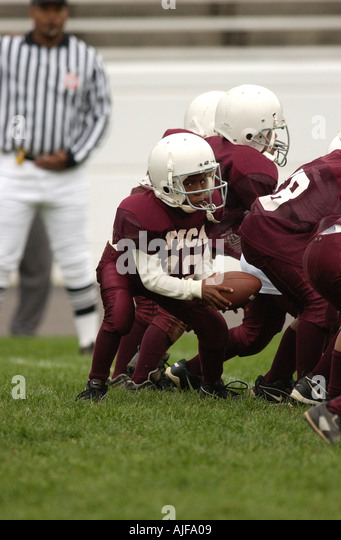 Youth biddy American football action  - Stock Image