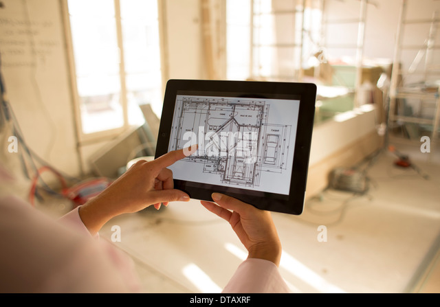Architect woman working with electronic tablet on Construction site - Stock-Bilder