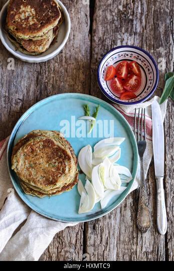 vegan zucchini chickpeas flour pancakes - Stock Image