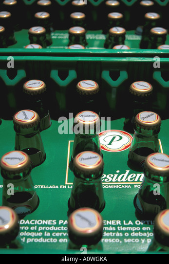 Dominican Republic Presidente beer bottles in green cases - Stock Image