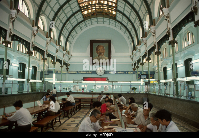 Vietnam Saigon Ho Chi Minh City General Post Office built 1880's interior customers Ho Chi Minh portrait - Stock Image