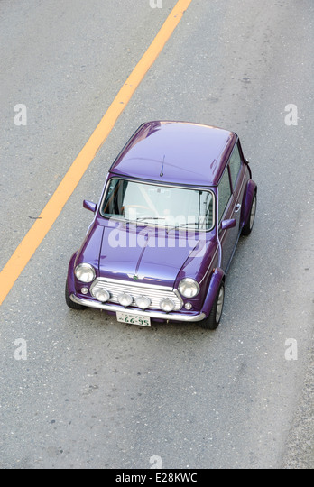 This modified example is seen cruising the streets of Osaka. - Stock Image