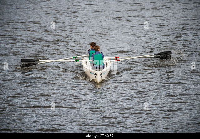 Sea cadets in a rowing boat on the river Rheidol, Aberystwyth Wales UK - Stock Image