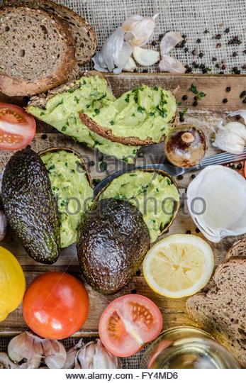 Guacamole is very tasty puree of avocado - Stock Image