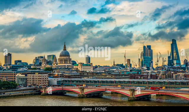 London skyline on a stormy day with the historical landmarks of St Paul's Cathedral, Blackfriars Bridge and - Stock Image