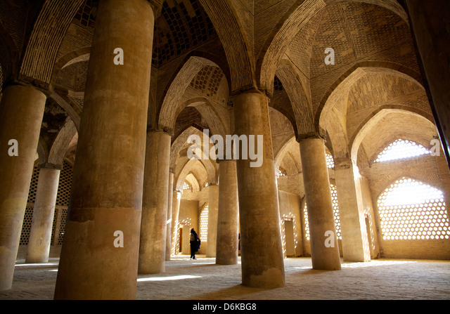 In the great columns room of the Great Mosque, Isfahan, Iran, Middle East - Stock Image