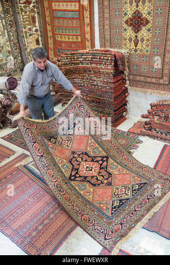 carpet trader, Mashhad, Iran, Western Asia - Stock Image