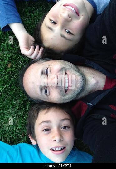 Father and sons - Stock Image
