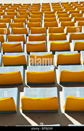 Yellow seats in sports city stadium Beirut Lebanon - Stock Image