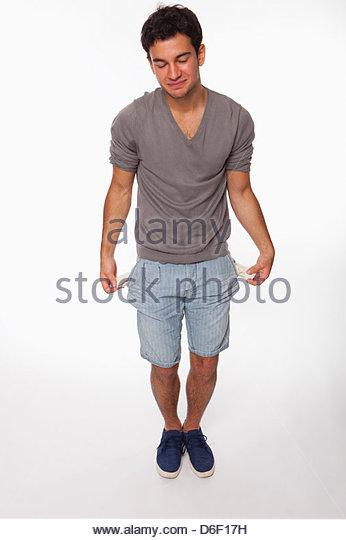 poor teenager male empty pockets money poverty - Stock Image