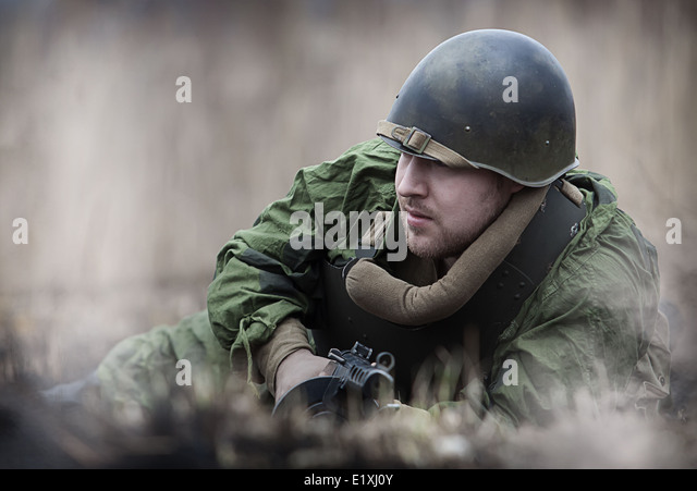 Young man in Red Army form posing with the PPSh-41 (Soviet submachine gun) - Stock Image