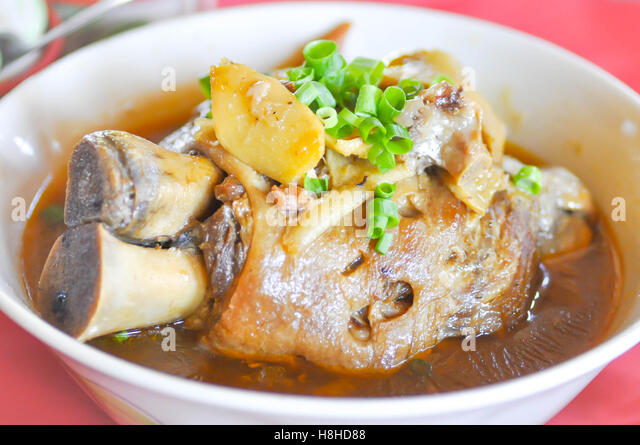 Stewed pork leg with vegetable dish - Stock Image