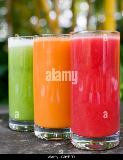Glasses of cucumber, carrot and watermelon fruit juice outside the Top Deck Restaurant, Ananda in the Himalayas,India - Stock Image