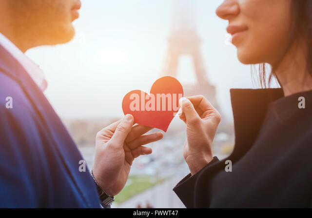 love and romance, couple on honeymoon near Eiffel Tower in Paris, heart for Valentines day - Stock-Bilder