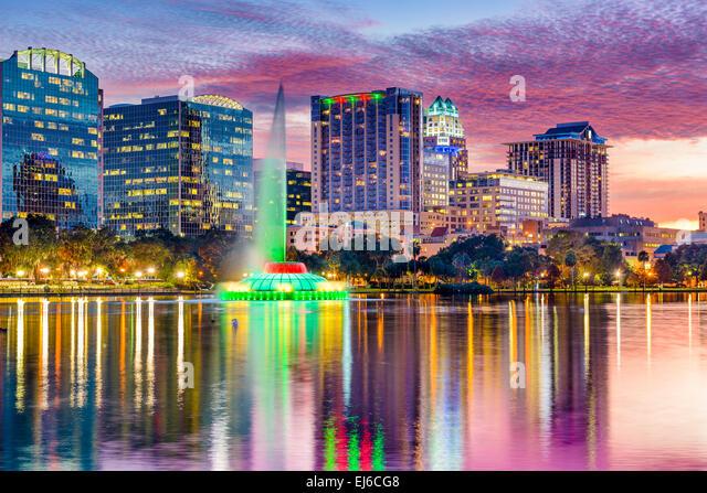 Orlando, Florida, USA skyline at dusk on Eola Lake. - Stock Image