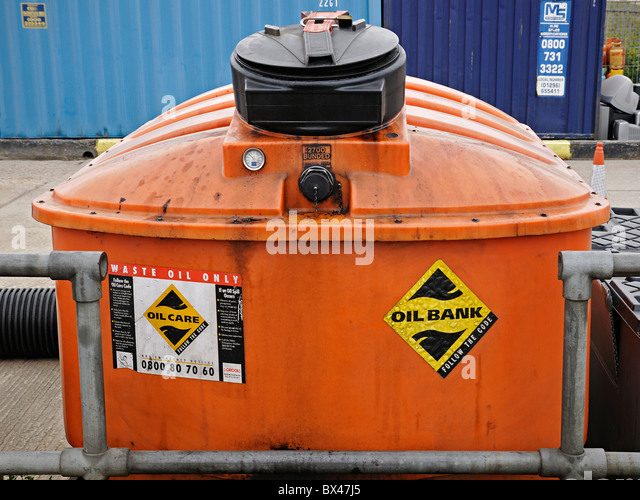 Oil Bank at a Recycling and Waste Management Centre, UK. - Stock Image