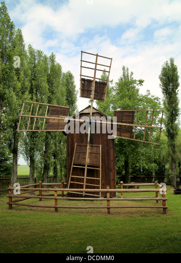 Retro image of old wooden Windmill - Stock Image