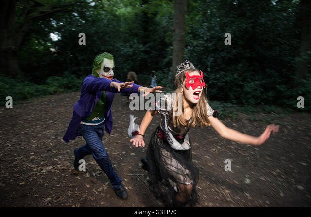 Two children in costume for Halloween Night. - Stock Image