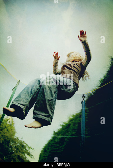 girl jumping on a trampoline - Stock-Bilder