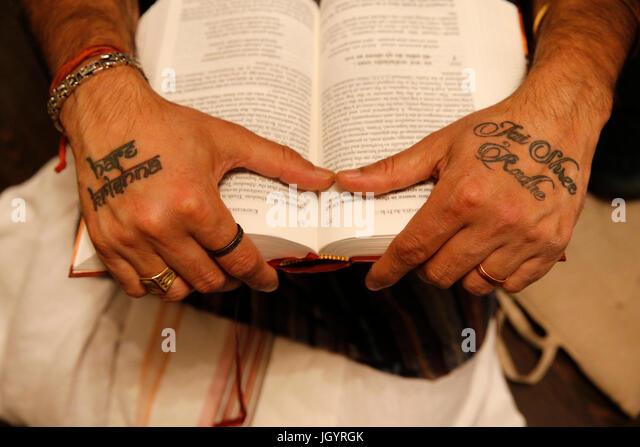 Gita Jayanti celebration in an ISKCON temple. Devotee reading the Bhagavad Gita. Sarcelles. France. - Stock Image