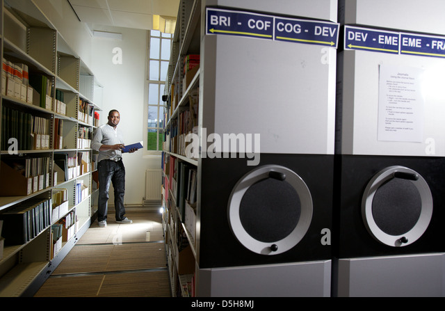 student reading in archival section of library - Stock Image