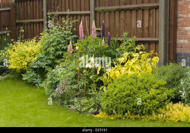 Garden border stock photos garden border stock images for Attractive garden fencing