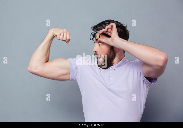 two shirtless men showing biceps isolated on white