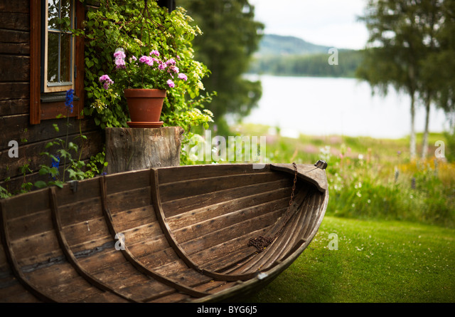 Wooden rowboat in backyard - Stock Image