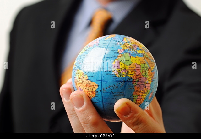 Businessman Holding a Globe in His Hand, Close Up. - Stock Image