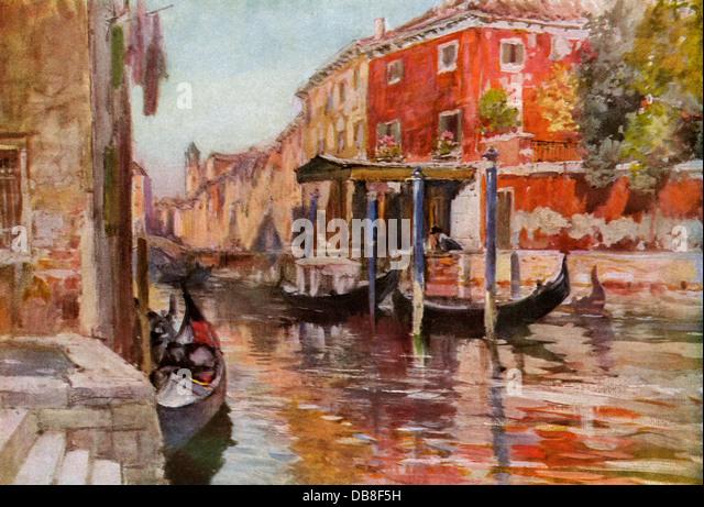 Gondolas along a canal in Venice, circa 1900. - Stock Image
