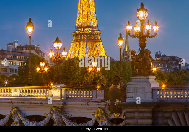 Twilight over Pont Alexandre III with Eiffel Tower beyond, Paris, France - Stock Image