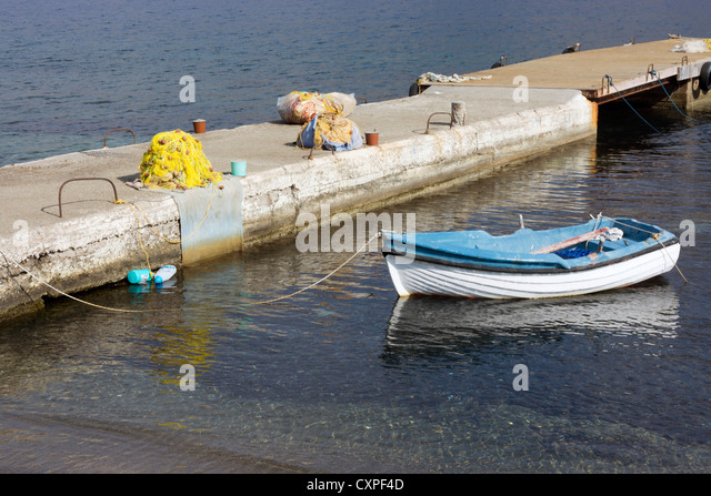 Blue and white rowing boat, Kalymnos, Greek Island, Dodecanese, Greece - Stock Image