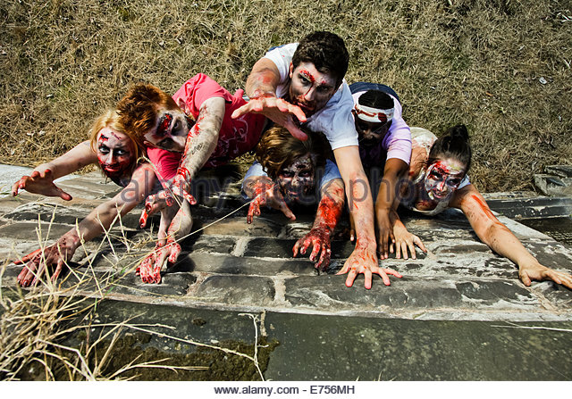 Birmingham Zombie Walk rehearsal, with a group of 'zombies' wearing realistic make-up and clothes. - Stock Image