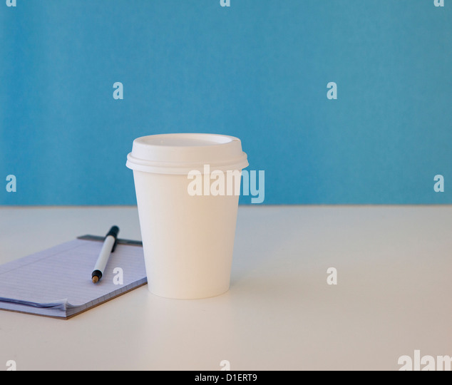 coffee or tea cup sits on table or desk - Stock-Bilder