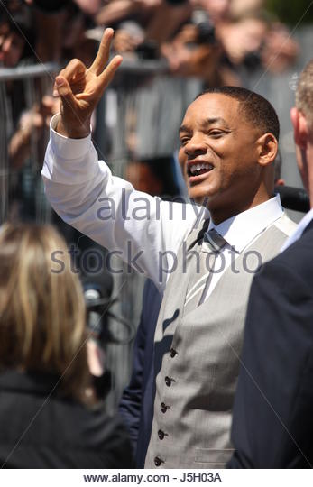 Cannes, France. 17th May, 2017. US actor and member of the Feature Film jury Will Smith greets fans as he arrives - Stock Image
